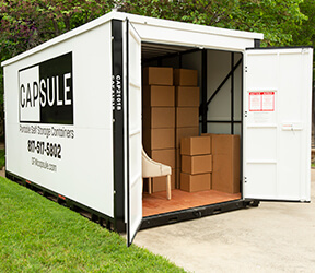 an open CAPSULE container on a driveway