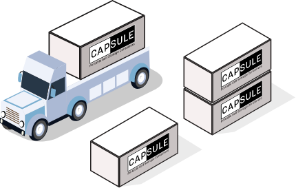 CAPSULE truck next to several CAPSULE containers