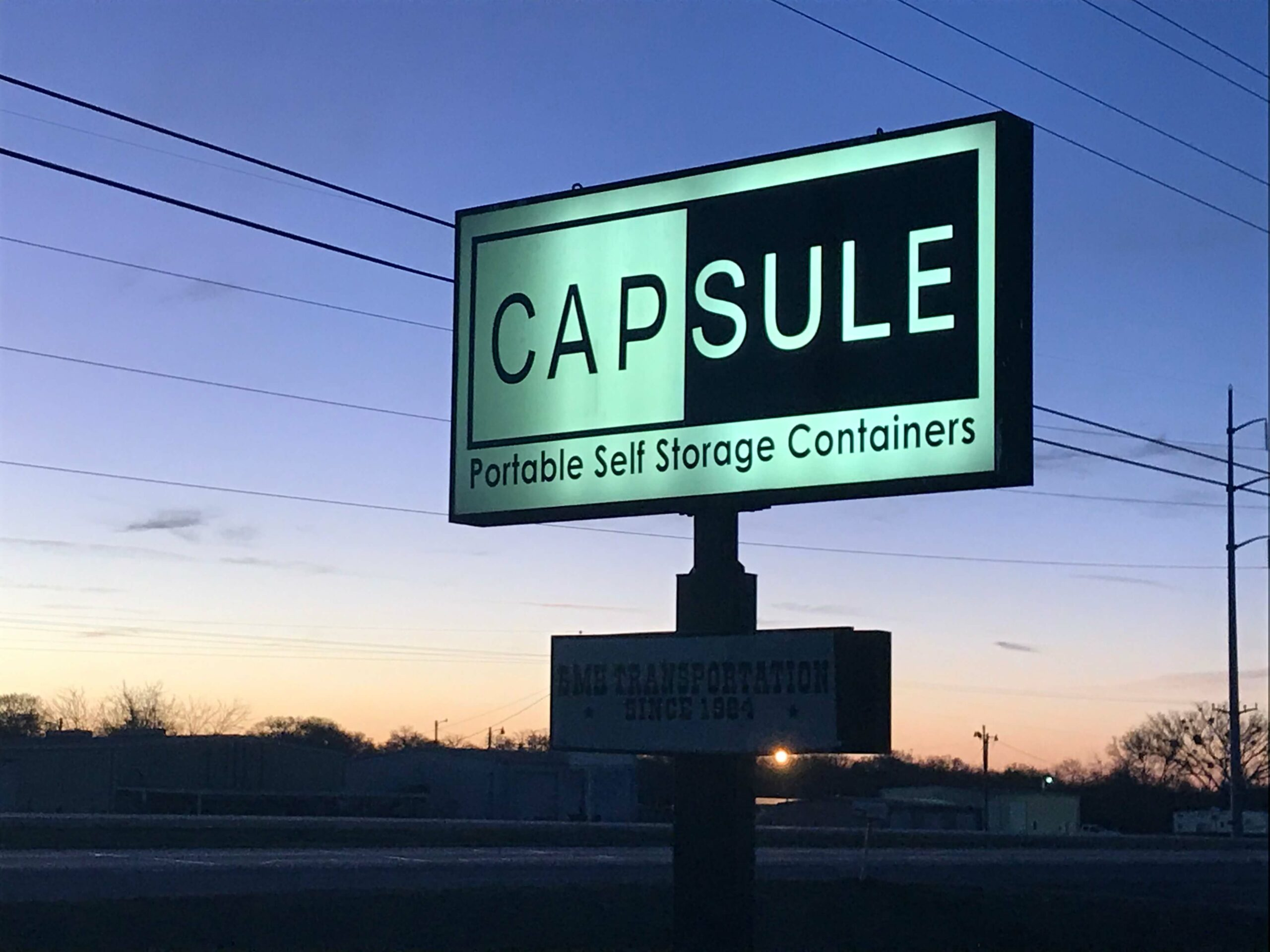 Capsule sign at sunrise